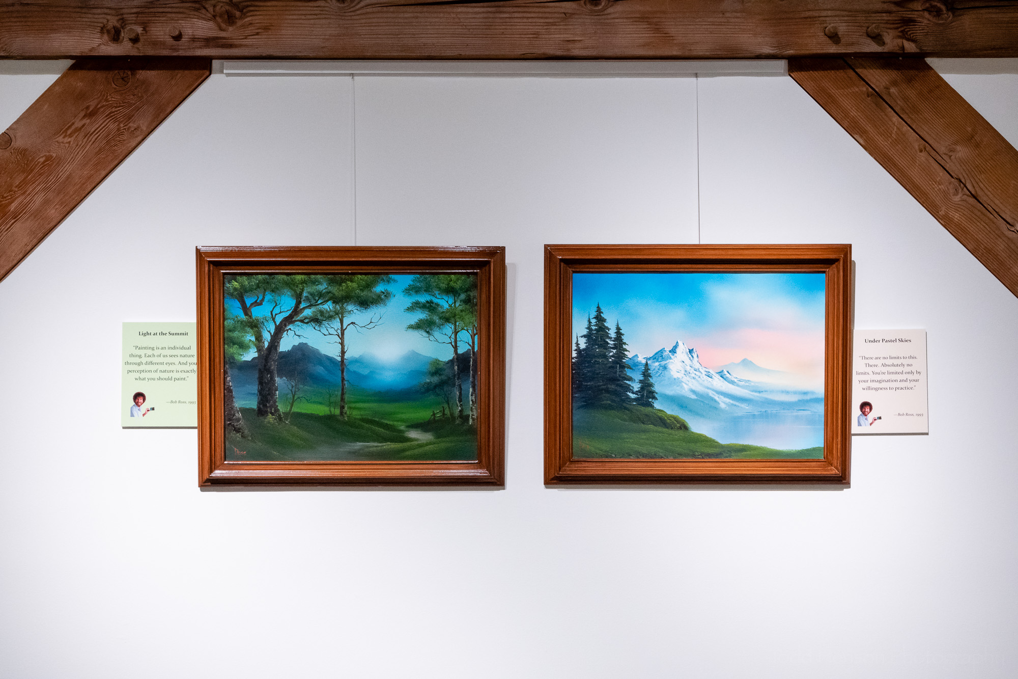 Light at the Summit , and  Under Pastel Skies , original oil paintings by Bob Ross, exhibited at Franklin Park Arts Center