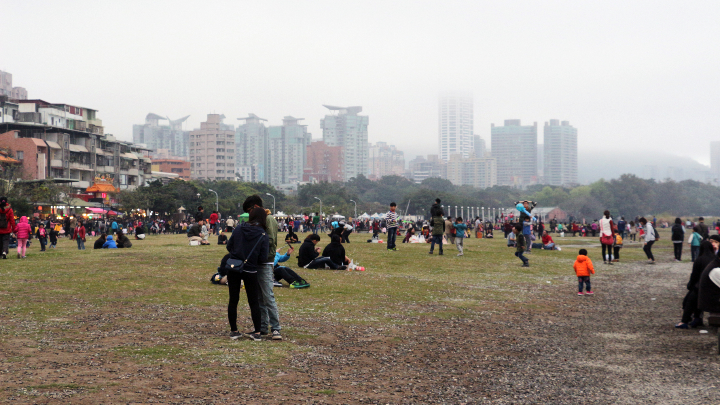 The river bank also has a park area where couples, families, and friends enjoy and relax.  It was a bit cloudy that day but there were still plenty of people out and about.