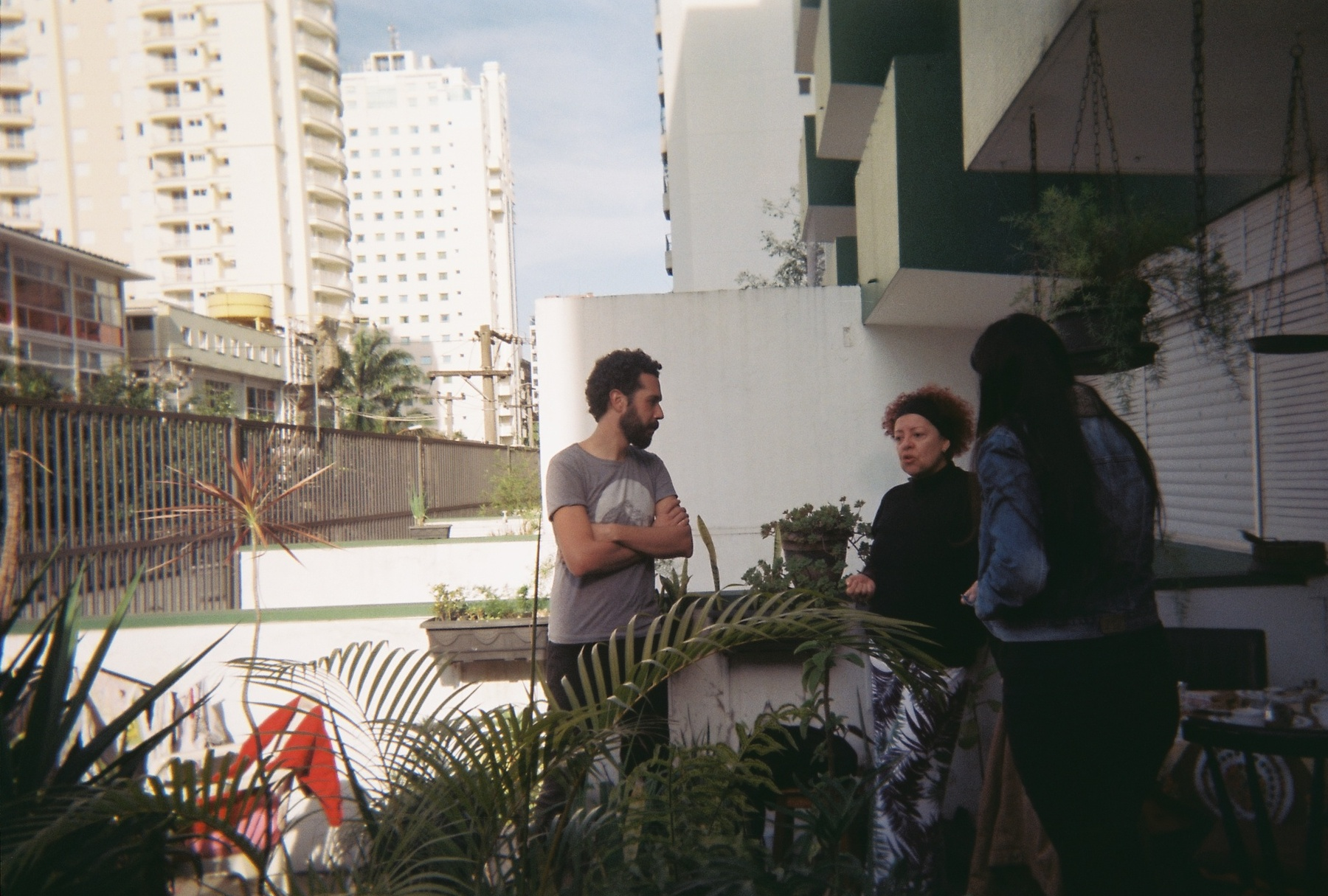 Coffee on the veranda (São Paulo) -- L-R Marcelo Florentino, Saundra Coutinho, Luiza Demoro