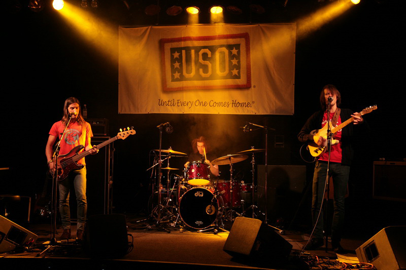 The Whigs (L-R) Tim Deaux, Julian Dorio and Parker Gisbert perform for troops at Ramstein Air Base in Germany, on the band's first-ever USO tour, May 22, 2010 (USO Photo by Jamie Goloyugo