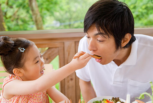 getty_rf_photo_of_dad_leading_by_example_eating_veggies.jpg