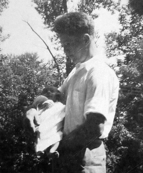 Margaret Ann Wolf Harris, 2 months old, with her father Cody Wolf before he reported to duty.