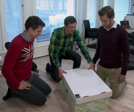 The founders of Finnish Baby Box Anton Danielsen, Heikki Tiittanen and Anssi Okkonen (L-R) pack their product in this still image taken from video in Espoo April 29, 2015. REUTERS/ATTILA CSER