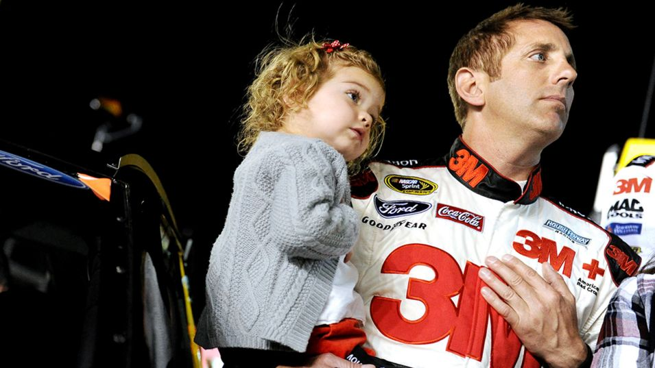 Greg Biffle holds daughter Emma at Daytona International Speedway in February 2014. Patrick Smith/Getty Images