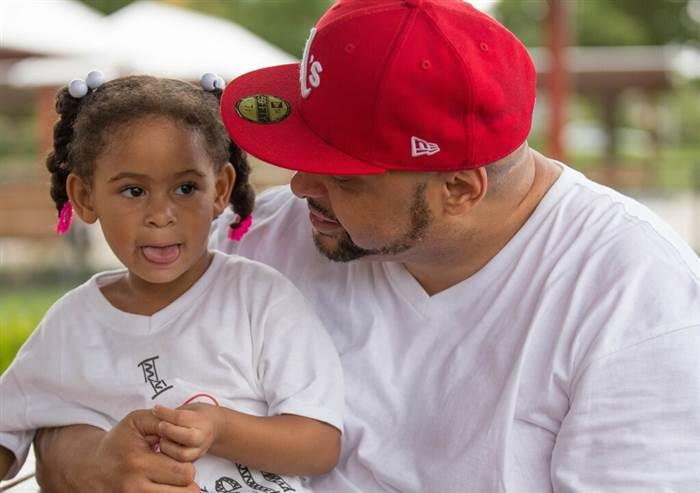 Khari Touré and his youngest daughter Maya share a moment.(Image:Khari Touré)