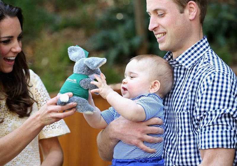 The duchess and duke play with Prince George. (Image: GettyImages)