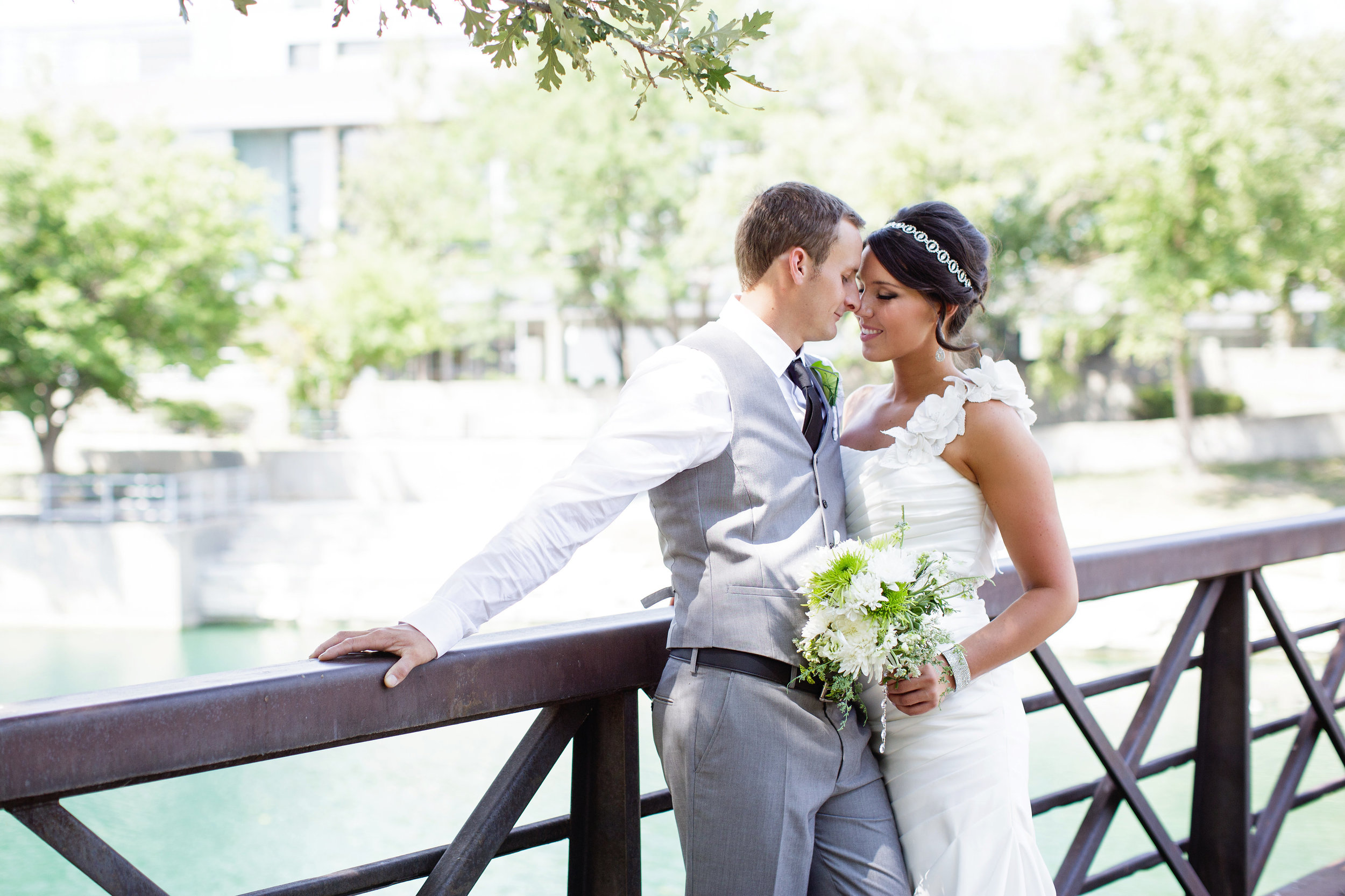 omaha-venue-the-living-room-white-black-downtown-wedding-gray-suit-bridge-bridal-portrait