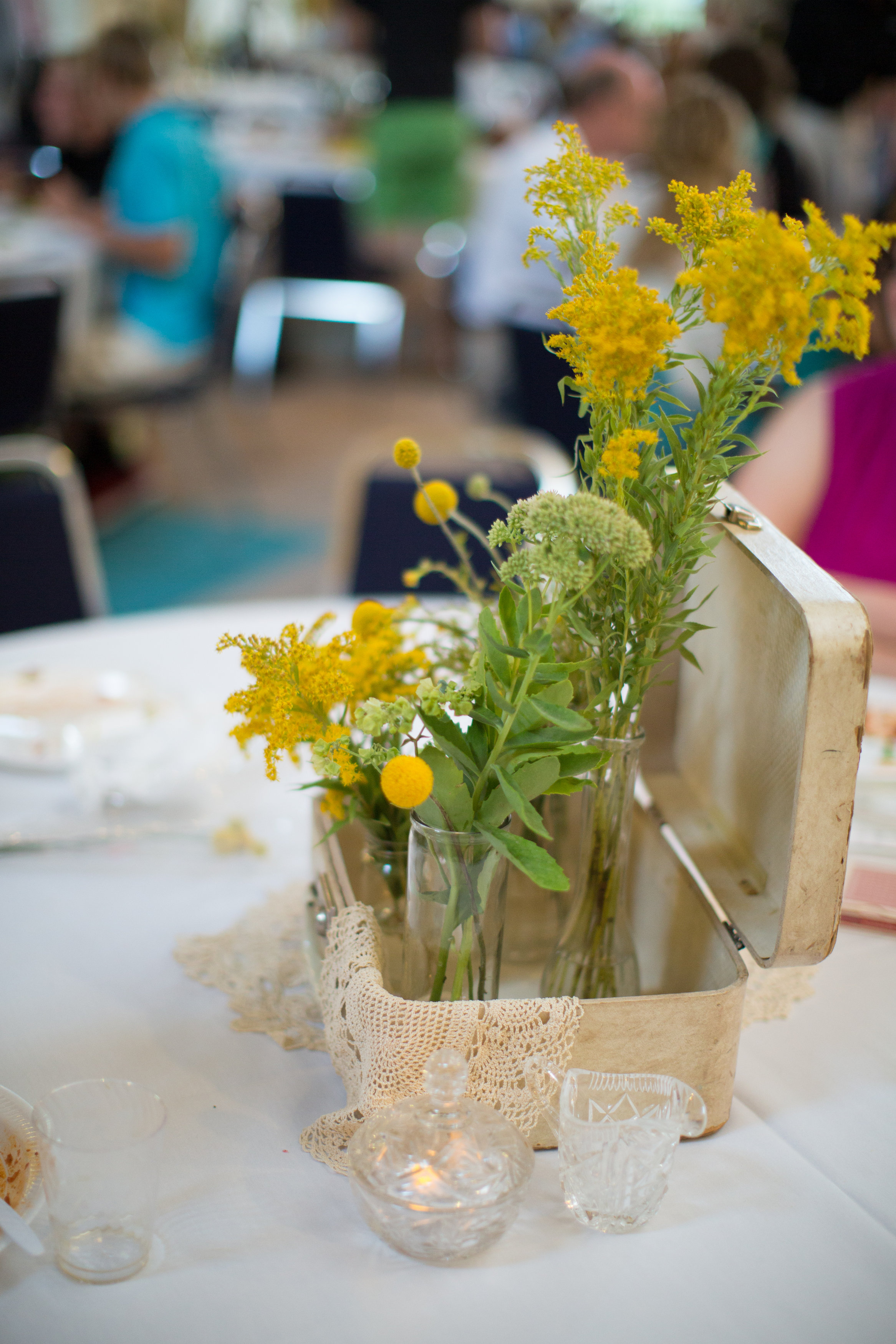 All of these flowers were planted by the bride's mom or grown in her garden! Photo by  Val Marlene