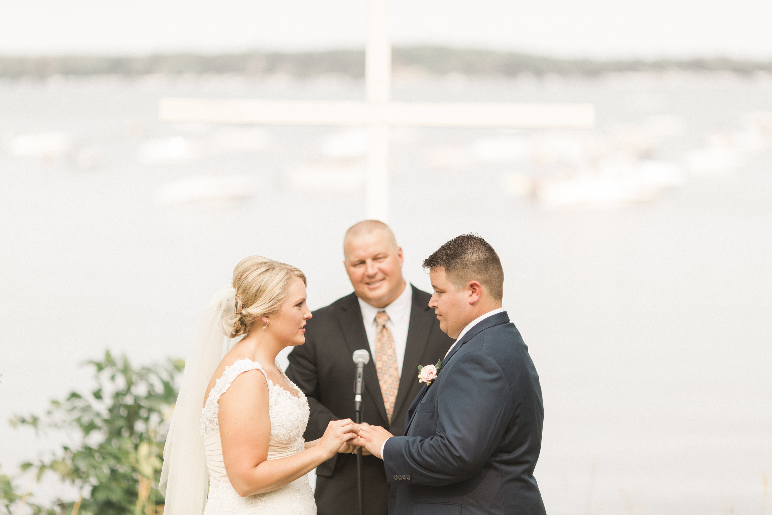 outdoor-iowa-wedding-ceremony-vows-with-a-lake-view-okoboji-iowa
