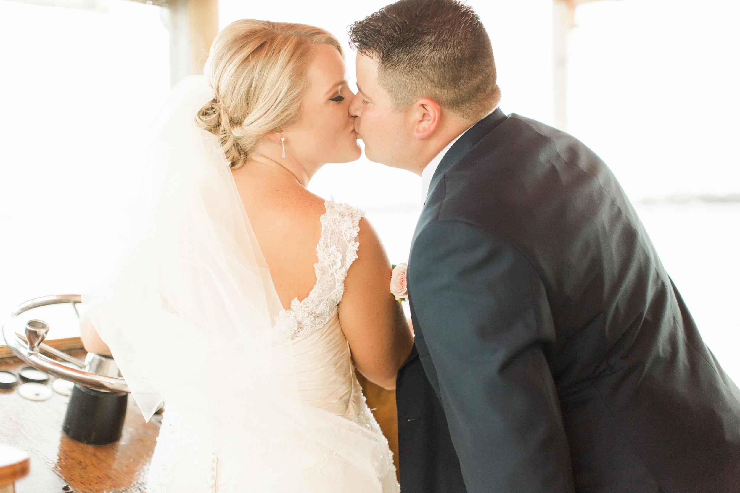 bride-groom-party-boat-kiss-white-veil-beaded-dress-blue-suit