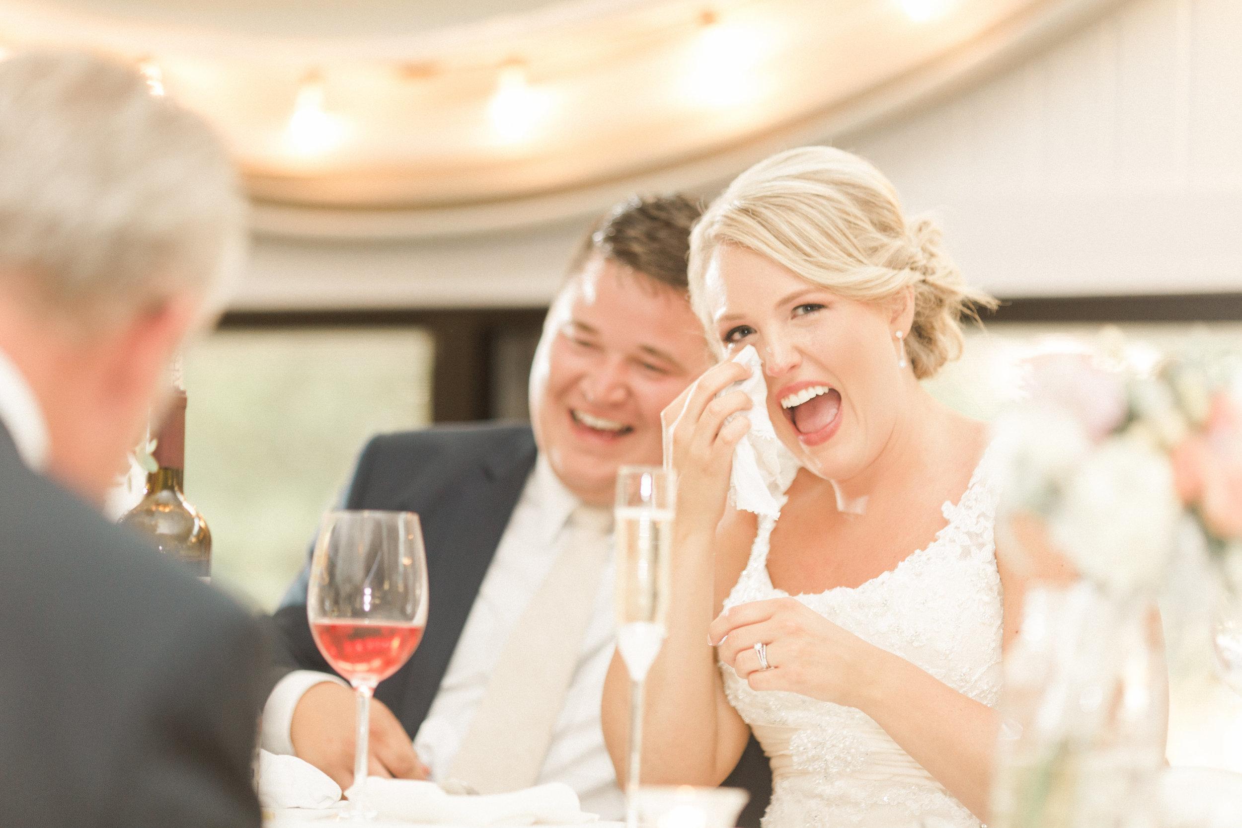 bride-candid-reception-toast-photo