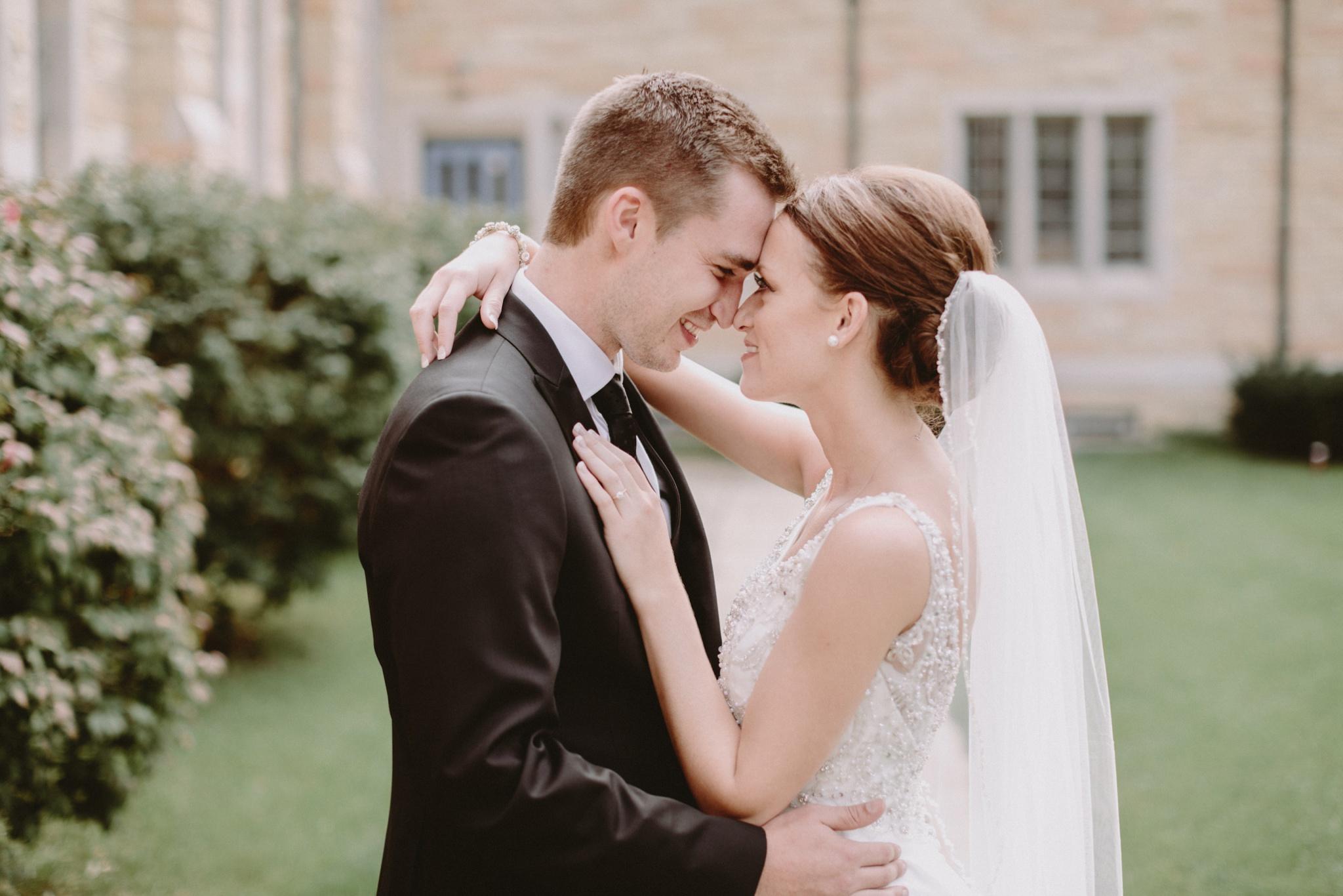 iowa-venue-fort-dodge-church-ceremony-bride-groom-portraits-white-veil-sleeveless-dress