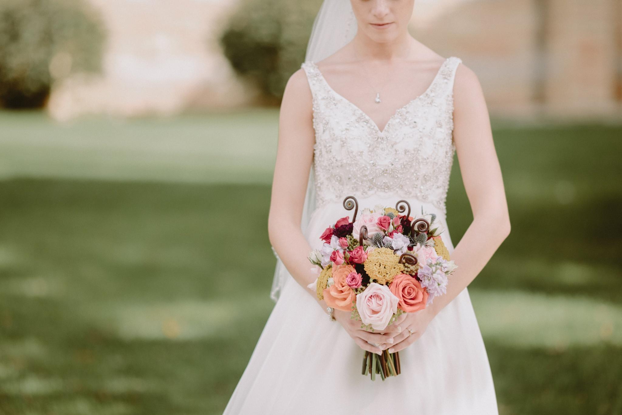 iowa-venue-fort-dodge-church-ceremony-sleeveless-dress-pink-coral-bouquet