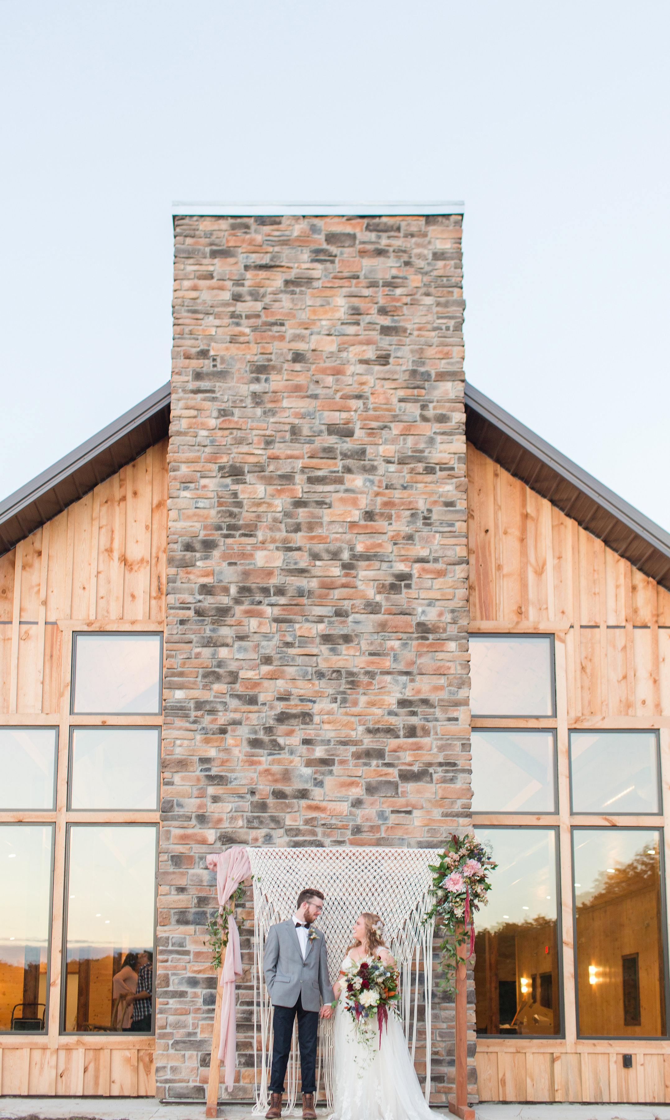 country-lane-lodge-adel-iowa-wedding-venue-white-lace-dress-purple-red-lush-bouquet-planned-by-mostly-becky-weddings-outdoor-ceremony-lodge-wedding