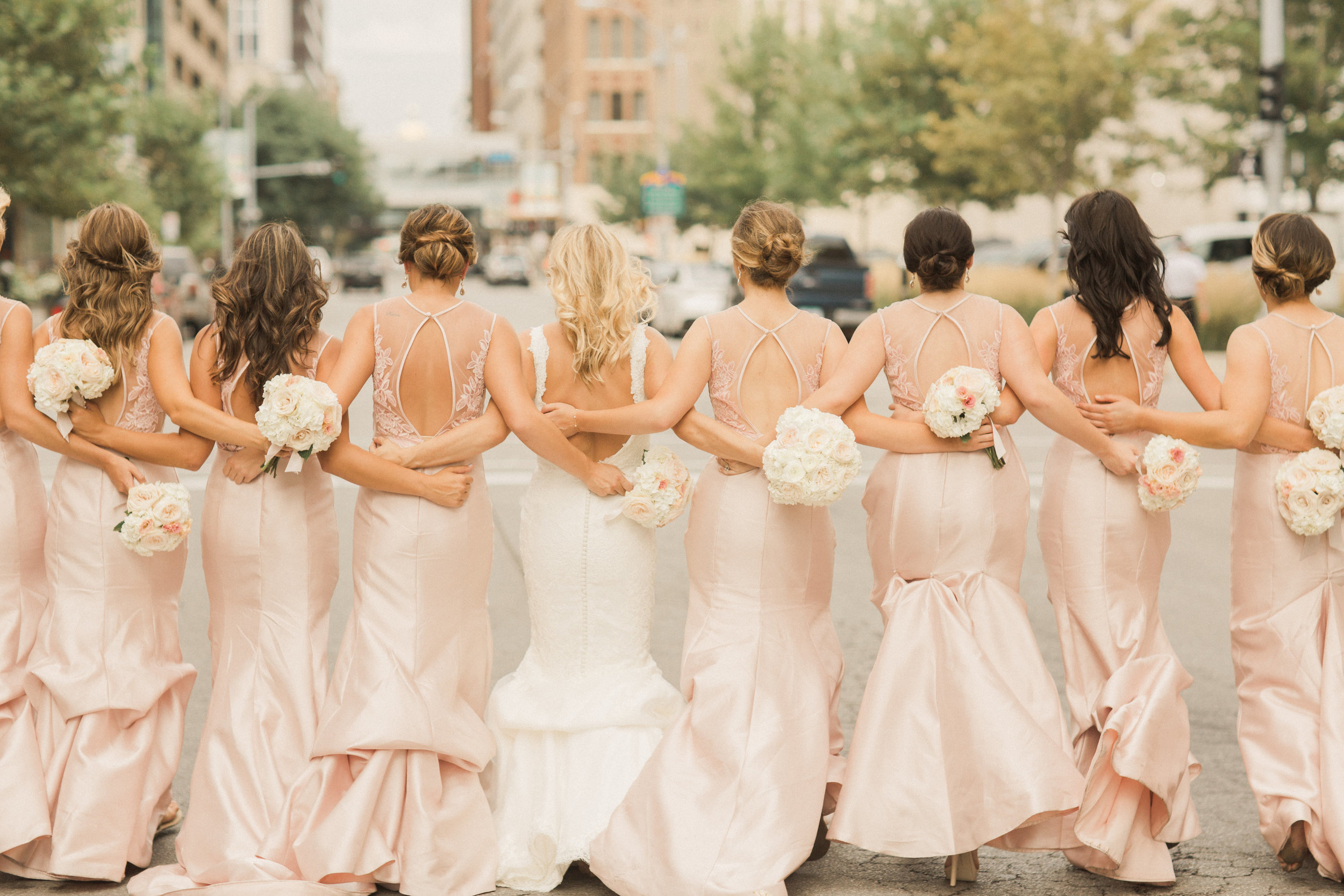 iowa-wedding-iowa-venue-blush-white-pink-bridesmaids-dresses-downtown-desmoines-planned-mostly-becky-weddings-outdoor-bridal-party-photos-black-tux-black-tie-event-bridesmaids-bridal-party-photos