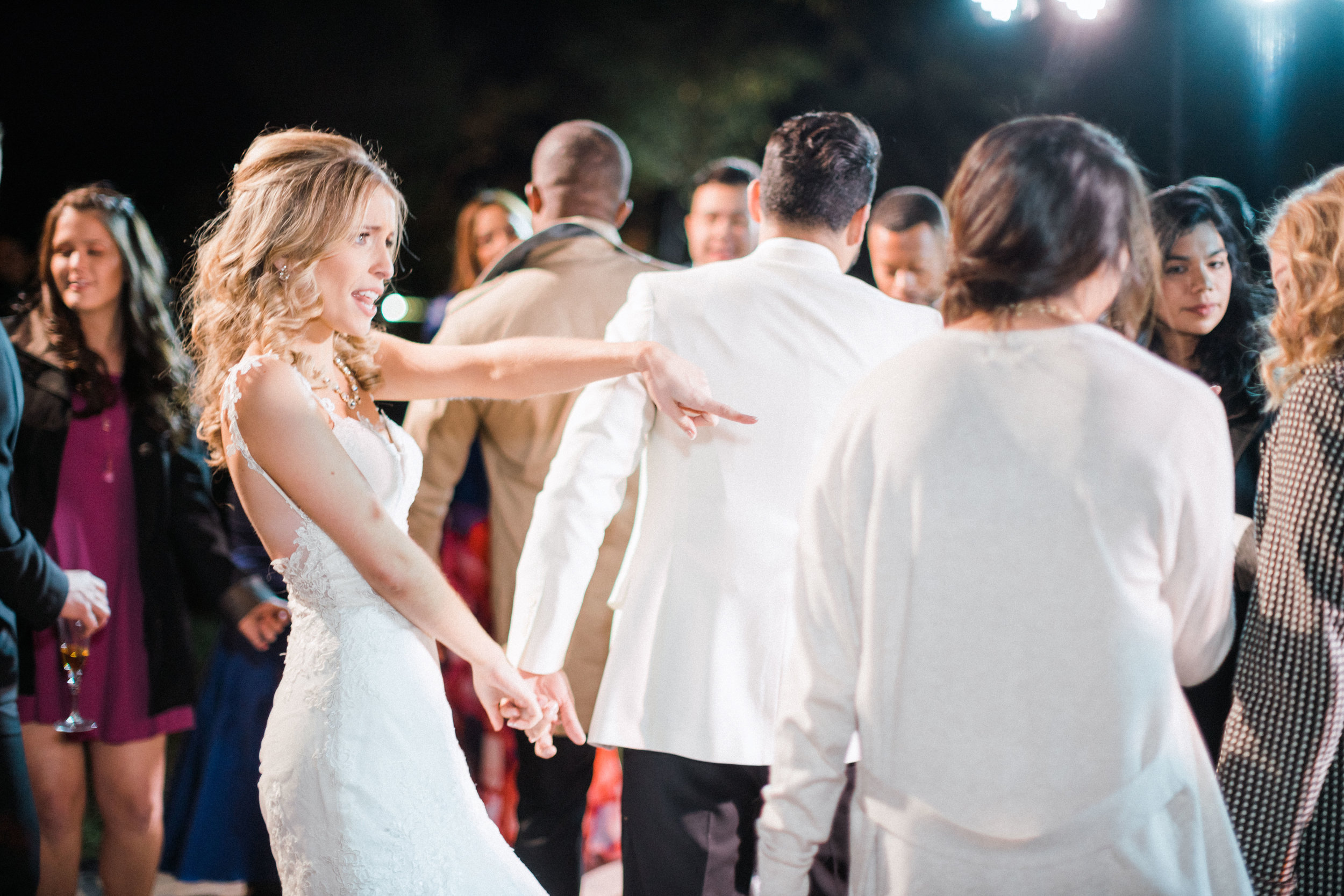 first-dance-florida-wedding-fort-myers-la-casa-toscana-outdoor-ceremony-winter-wedding-brown-chairs-white-gazebo-planned-by-mostly-becky-weddings-traveling-wedding-planner-destination-wedding-lakeside-bridal-portraits-bride-groom-black-tie-tux-formal-wedding