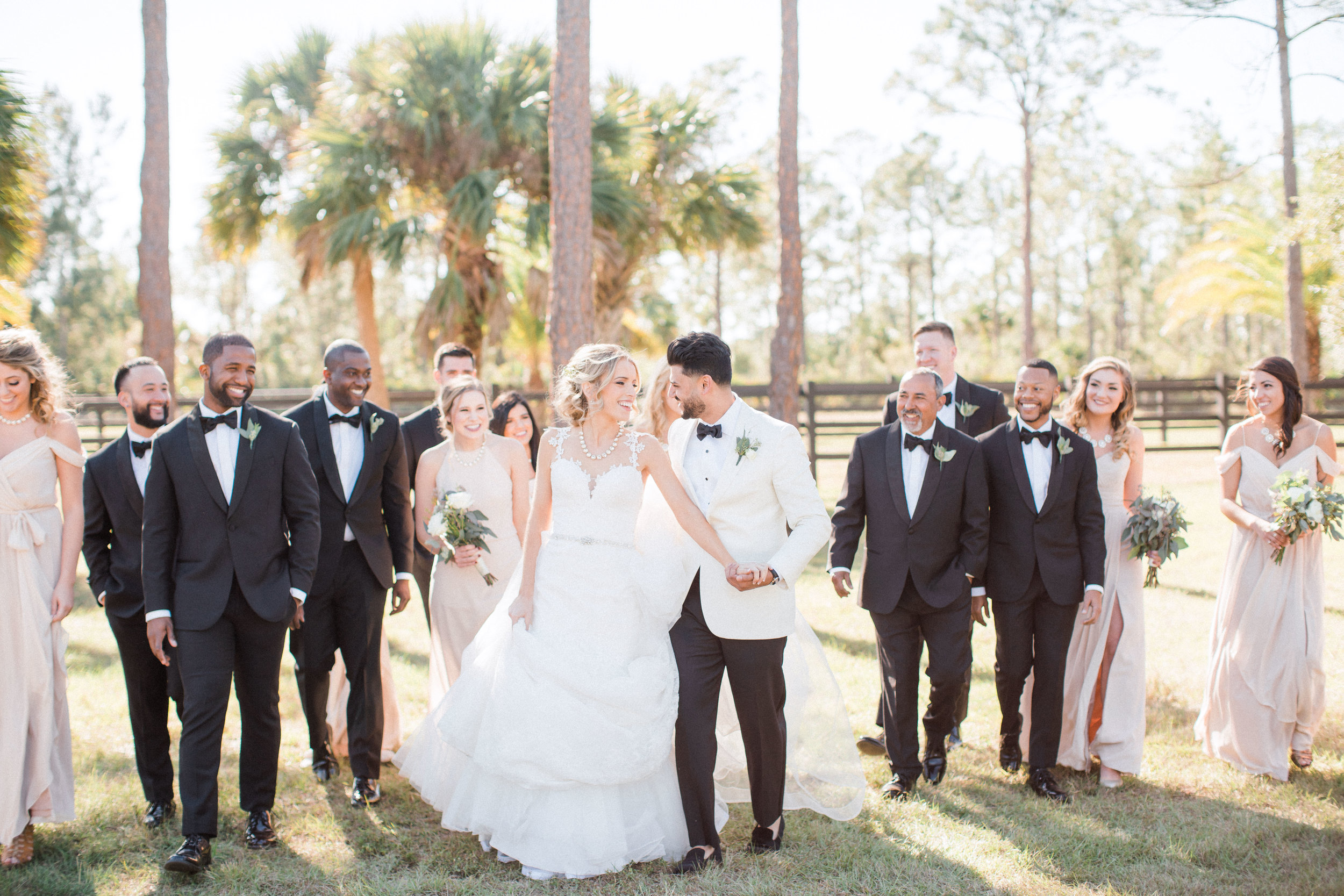 bridal-party-photos-florida-wedding-fort-myers-la-casa-toscana-outdoor-ceremony-winter-wedding-brown-chairs-white-gazebo-planned-by-mostly-becky-weddings-traveling-wedding-planner-destination-wedding-lakeside-bridal-portraits-bride-groom-black-tie-tux-formal-wedding