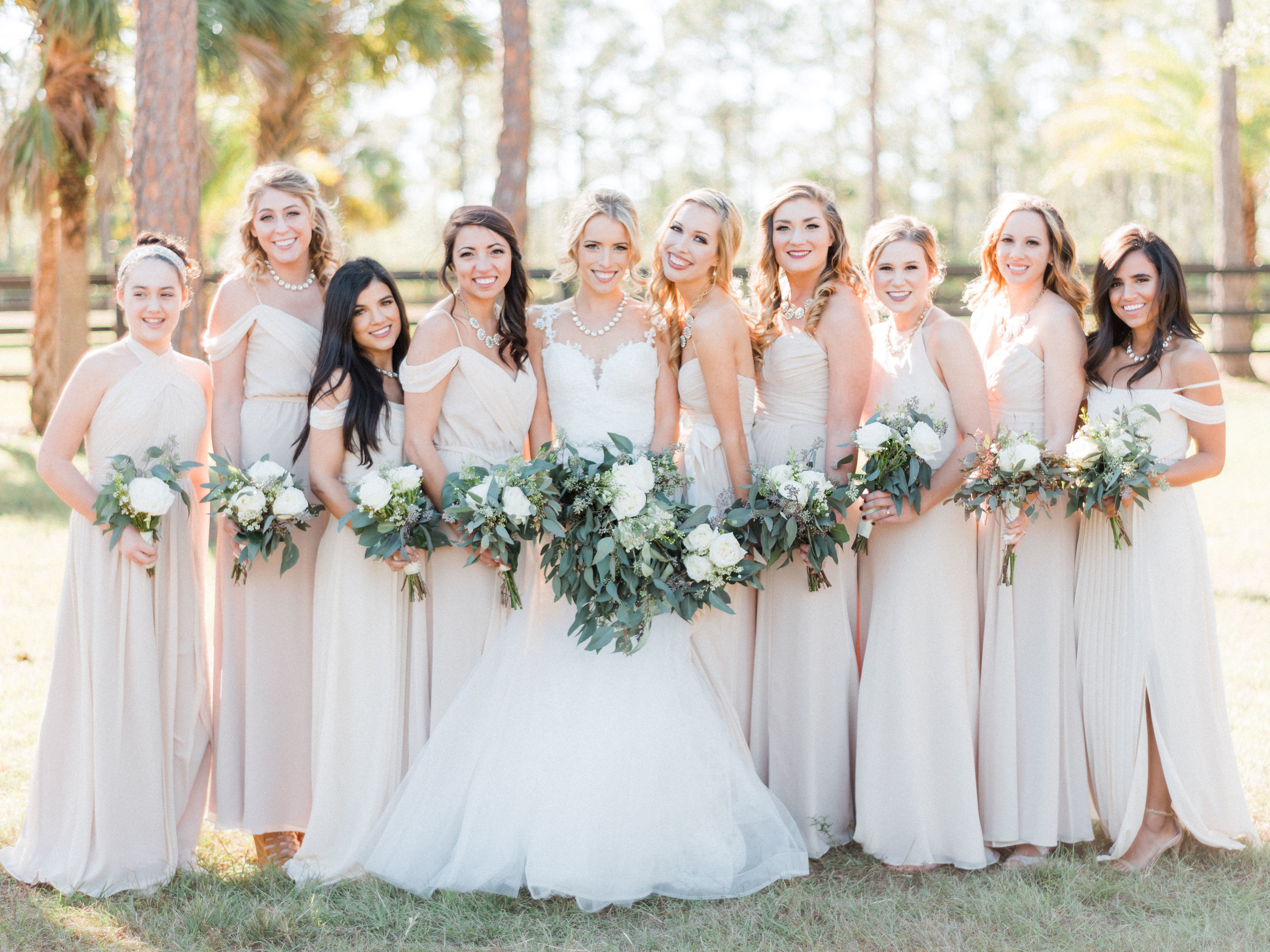 bridal-party-bridesmaids-florida-wedding-fort-myers-la-casa-toscana-outdoor-ceremony-winter-wedding-brown-chairs-white-gazebo-planned-by-mostly-becky-weddings-traveling-wedding-planner-destination-wedding-lakeside-bridal-portraits-bride-groom-black-tie-tux-formal-wedding