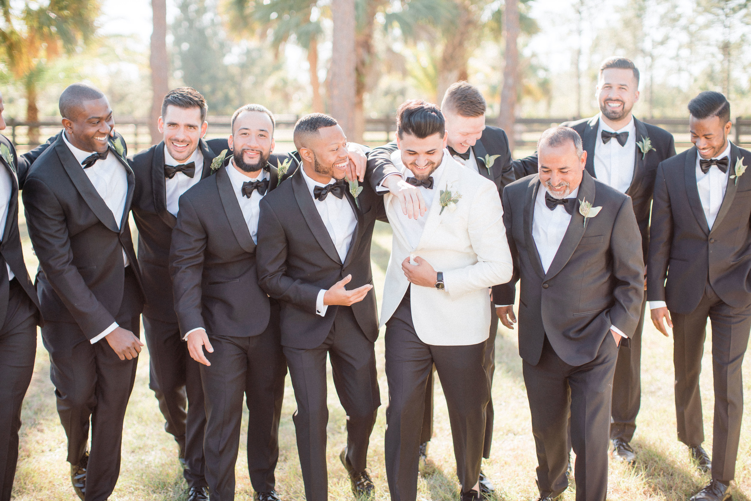 bridal-party-groomsman-florida-wedding-fort-myers-la-casa-toscana-outdoor-ceremony-winter-wedding-brown-chairs-white-gazebo-planned-by-mostly-becky-weddings-traveling-wedding-planner-destination-wedding-lakeside-bridal-portraits-bride-groom-black-tie-tux-formal-wedding