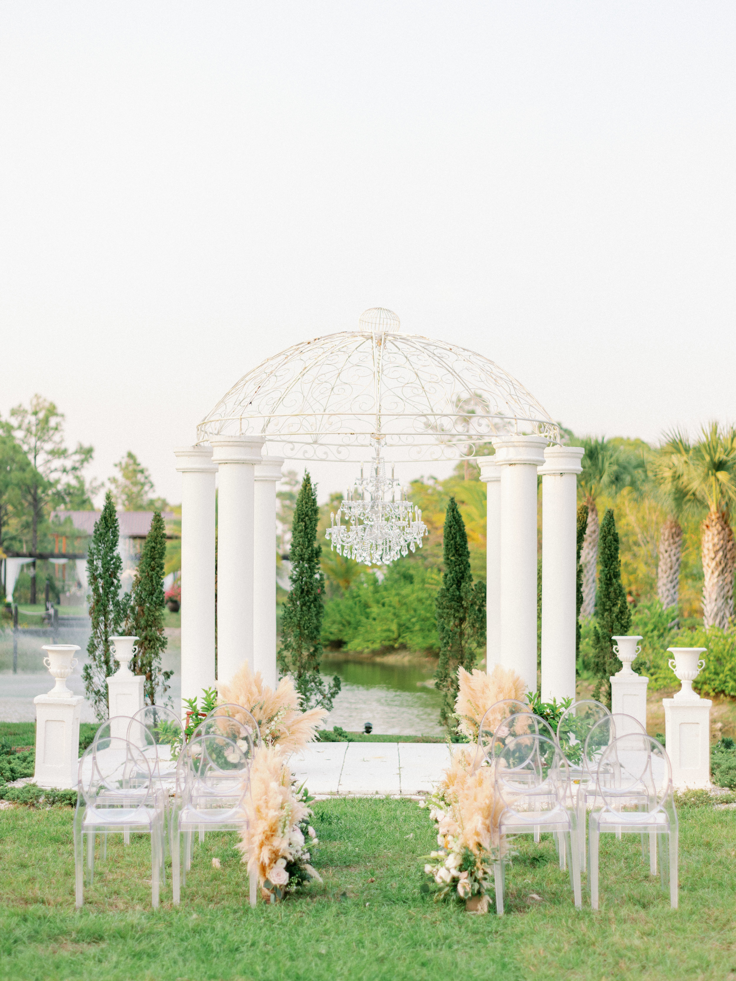 florida-wedding-fort-myers-la-casa-toscana-outdoor-ceremony-wedding-white-gazebo-planned-by-mostly-becky-weddings-traveling-wedding-planner-destination-wedding-lakeside-bridal-portraits-bride-groom-black-tie-tux-formal-wedding