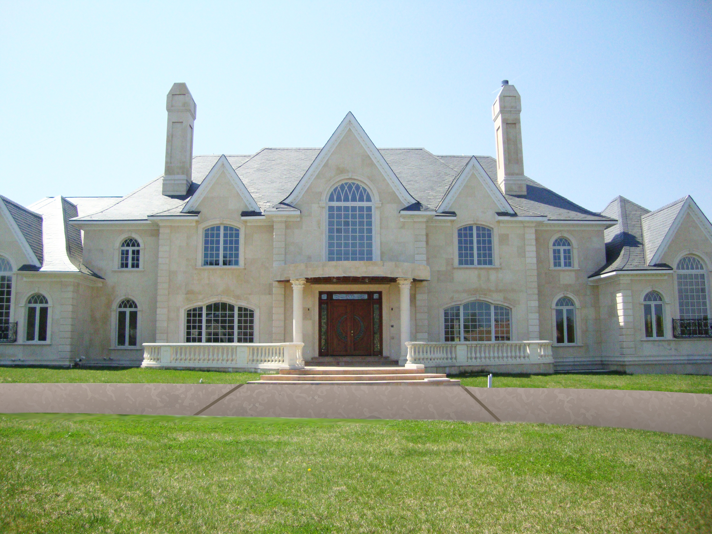 20,000 sq. ft of anchored limestone panels, including window surrounds and accents in Potomac, MD.