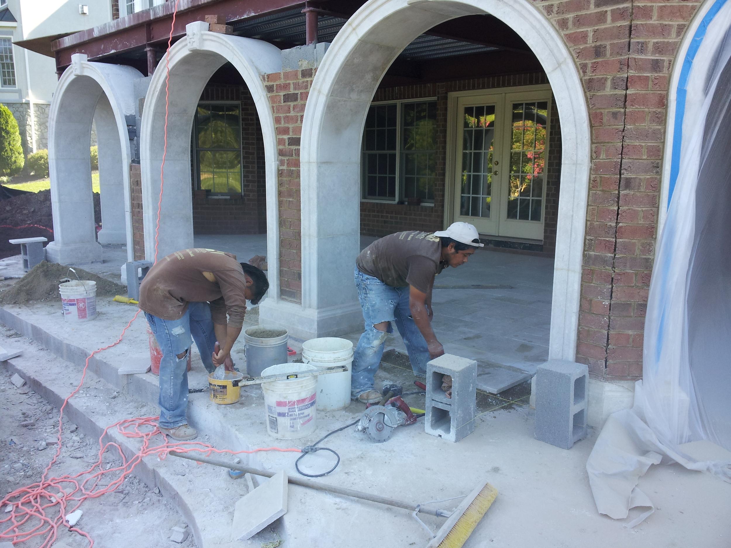 Brick starts being installed in-between arches to cover up the the steel and block.