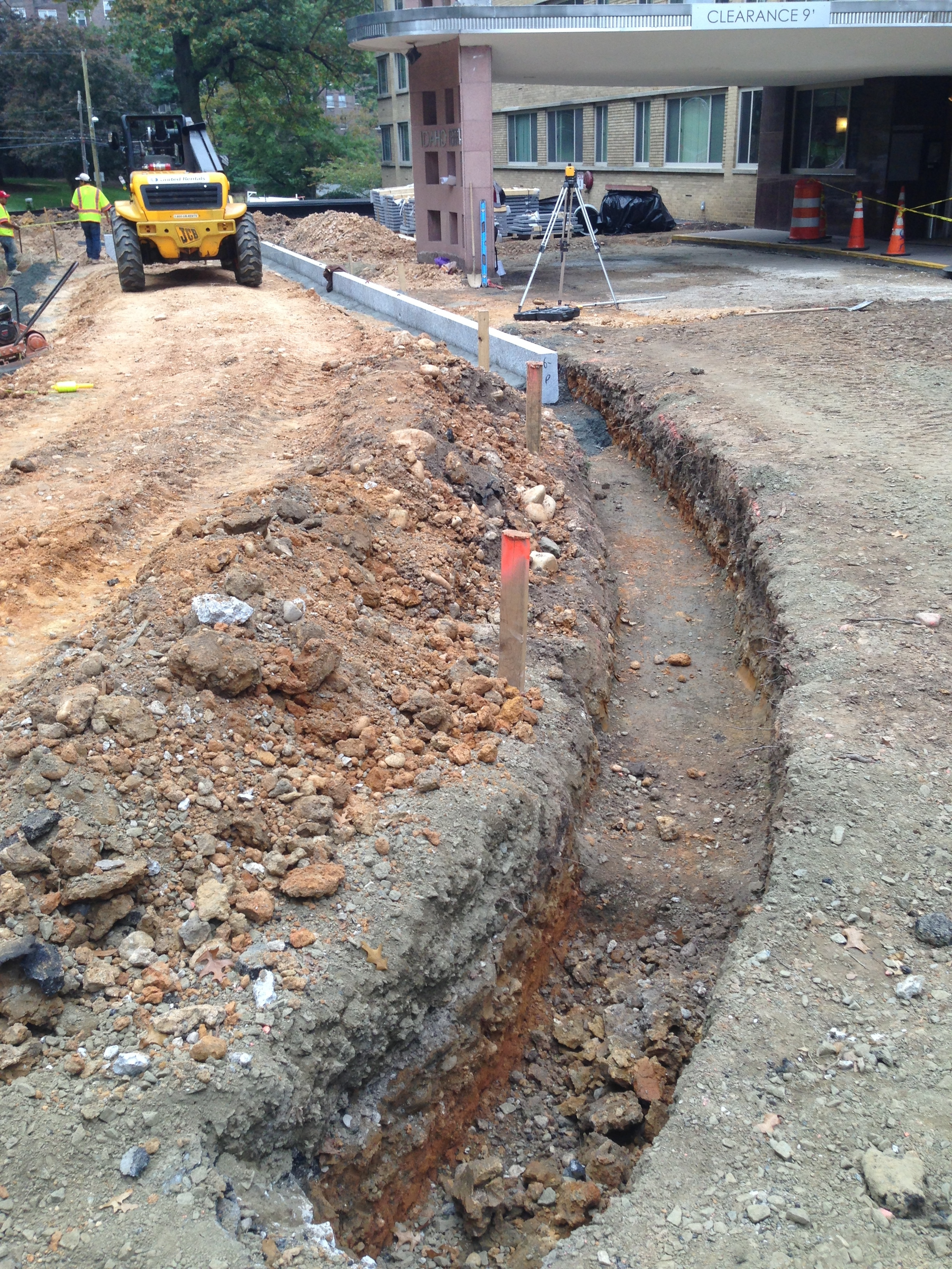 Verifying the levels and lines of the driveway and set stone.