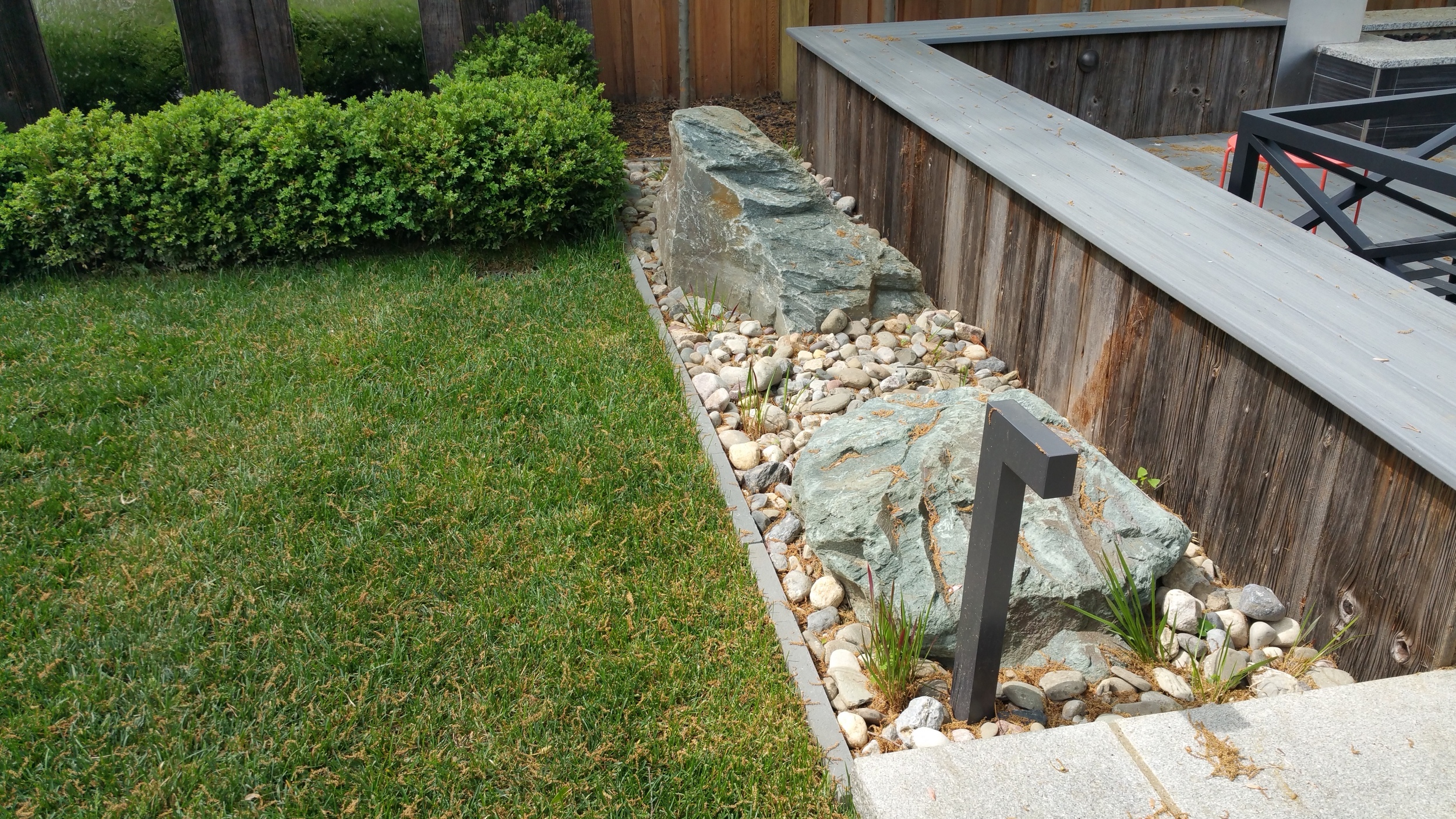 Boulders and rock garden with modern low voltage lighting features.