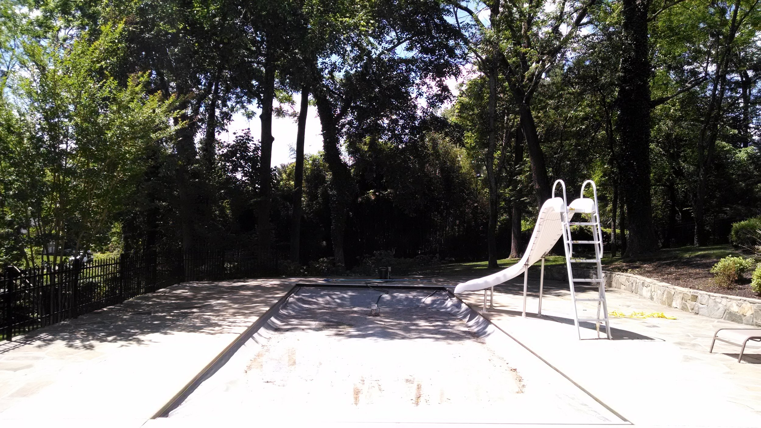 Before photo of with the existing fiberglass pool
