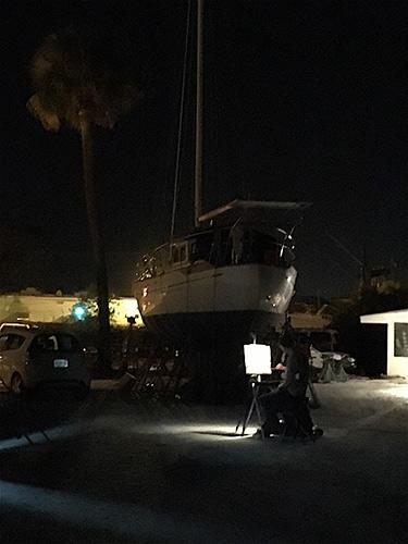 Jason Sacran painting a boatyard nocturne
