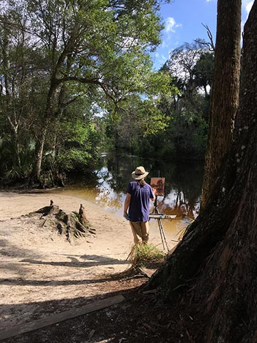 Judge Jim McVicker carved out some time to do some painting at the Riverbend Park canoe launch.