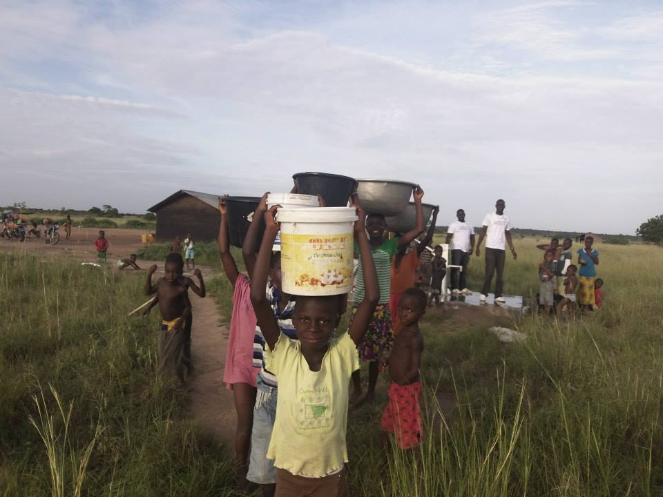 Children fetching water in Tsipasi, Ghana