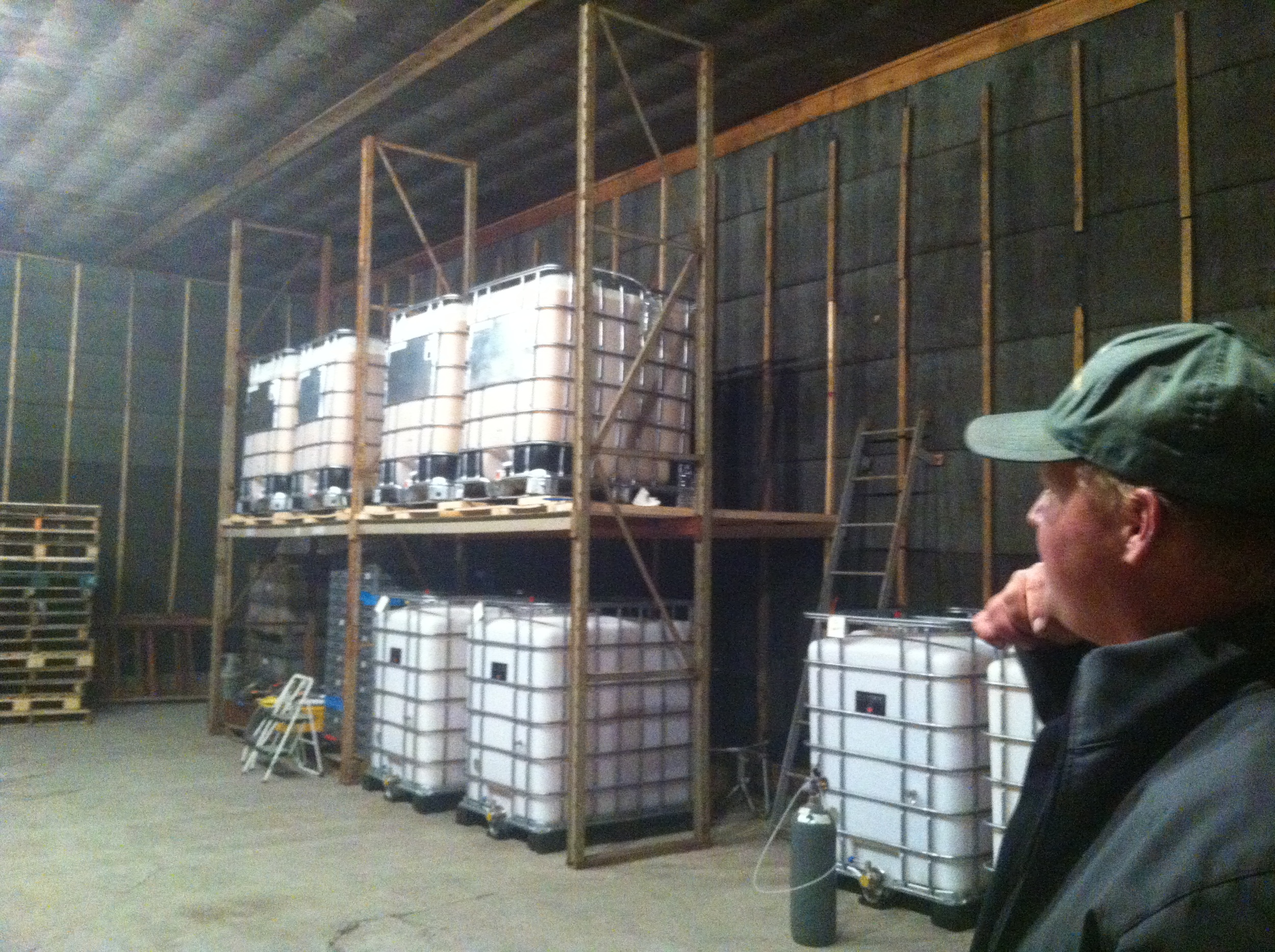 Cider-maker Albert shows us around the warehouse.