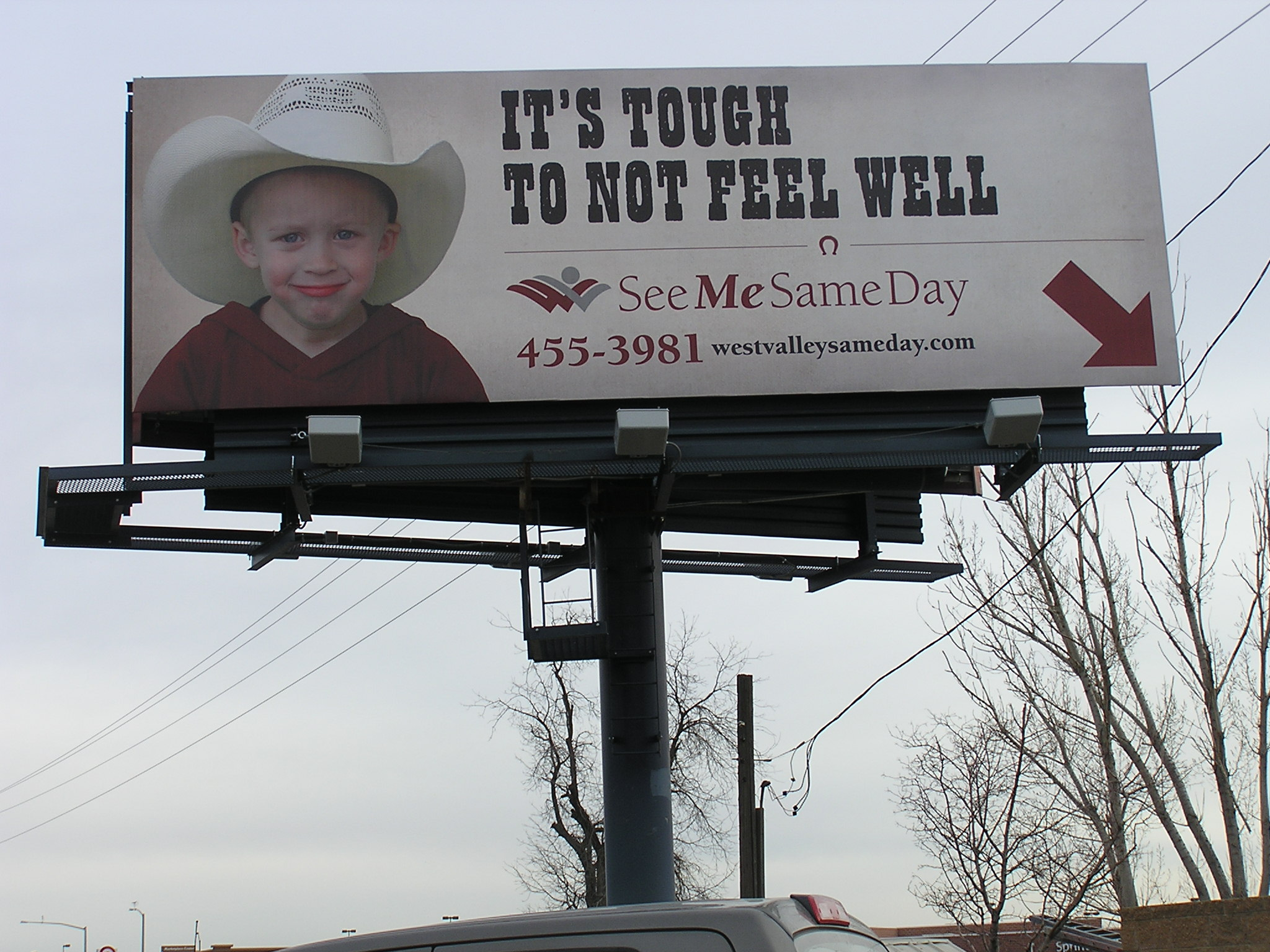 A billboard I designed to appeal to mothers and kids in West Valley, Idaho. You can be in and out of the West Valley Medical Center because of the See Me Same Day Service.