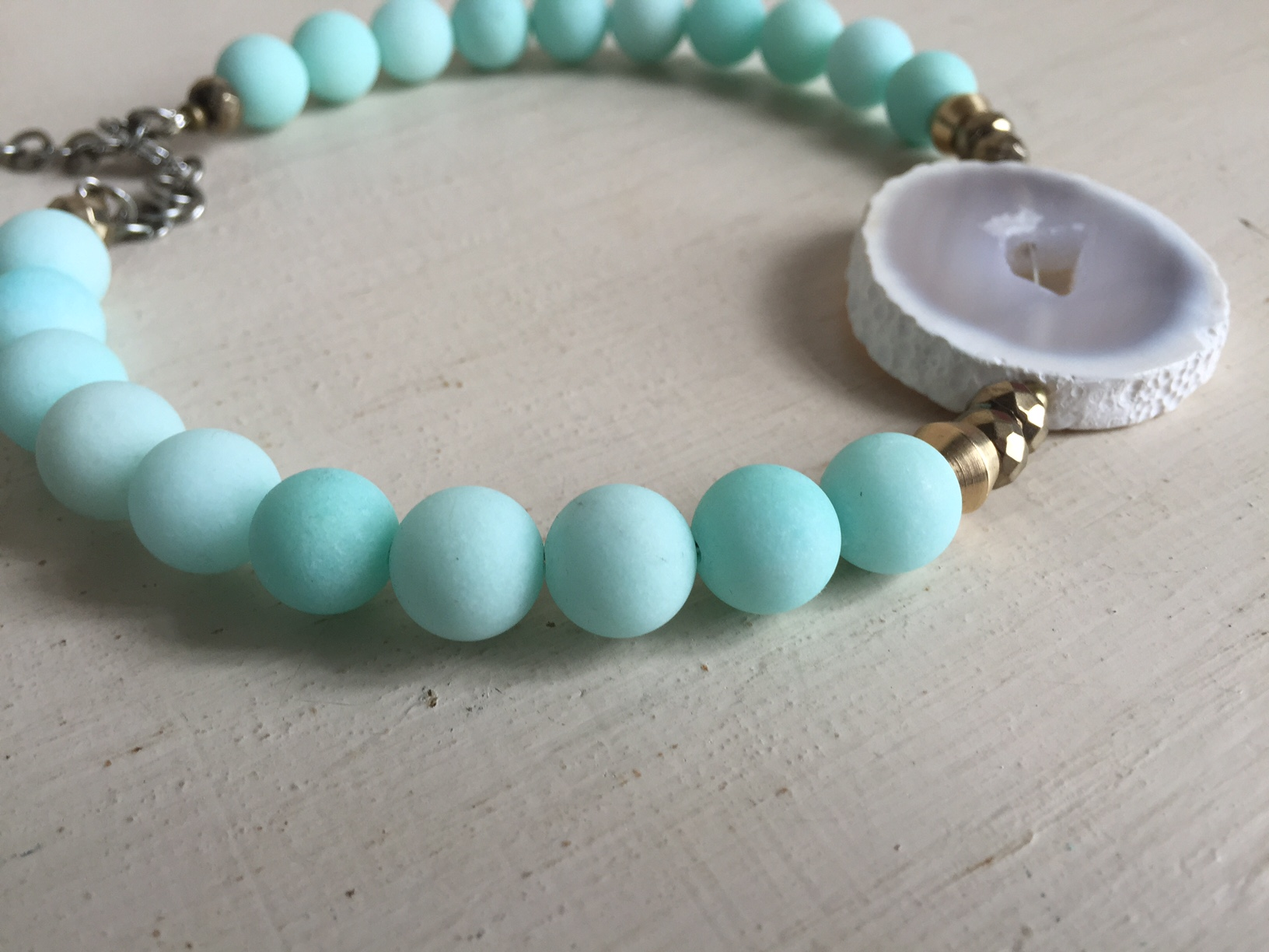 We are soooo in love with the beads on this choker! That color just screams spring!