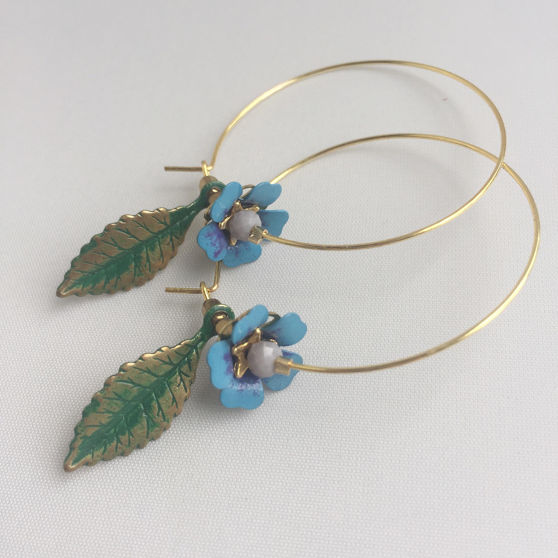 Blue Enamel Flower with Green leaf hoops $34
