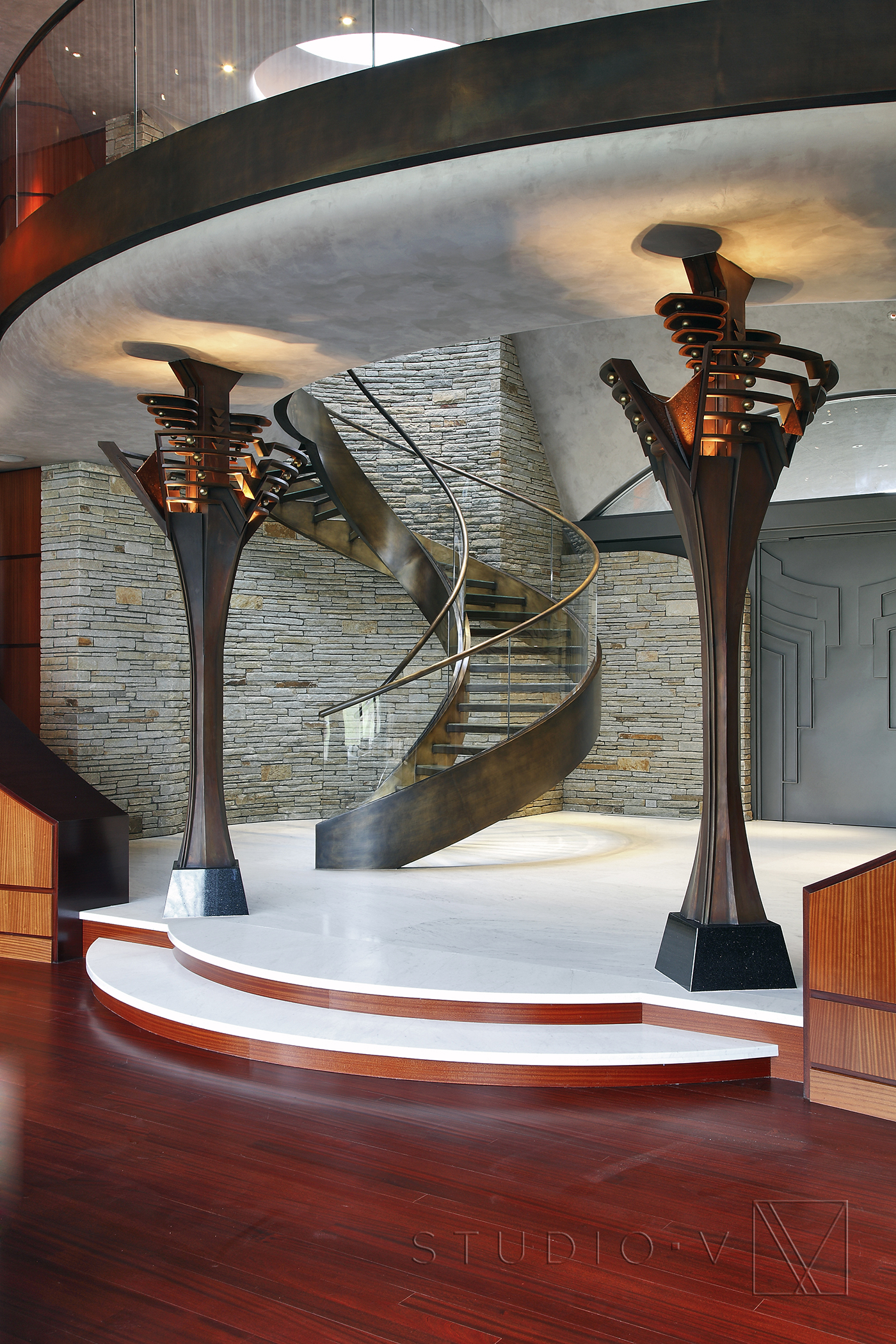 03_Foyer Custom Front Door Spiral Staircase Studio V Interiors Scottsdale AZ Greenwich CT.jpg