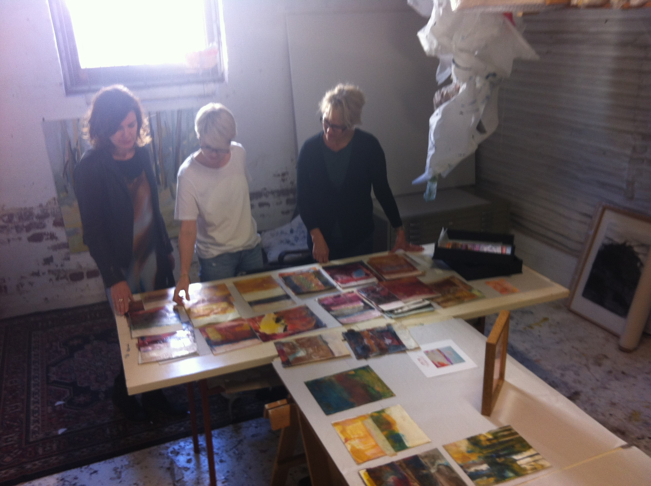 Kylie and Liz looking at my encaustic mono prints for our collaboration