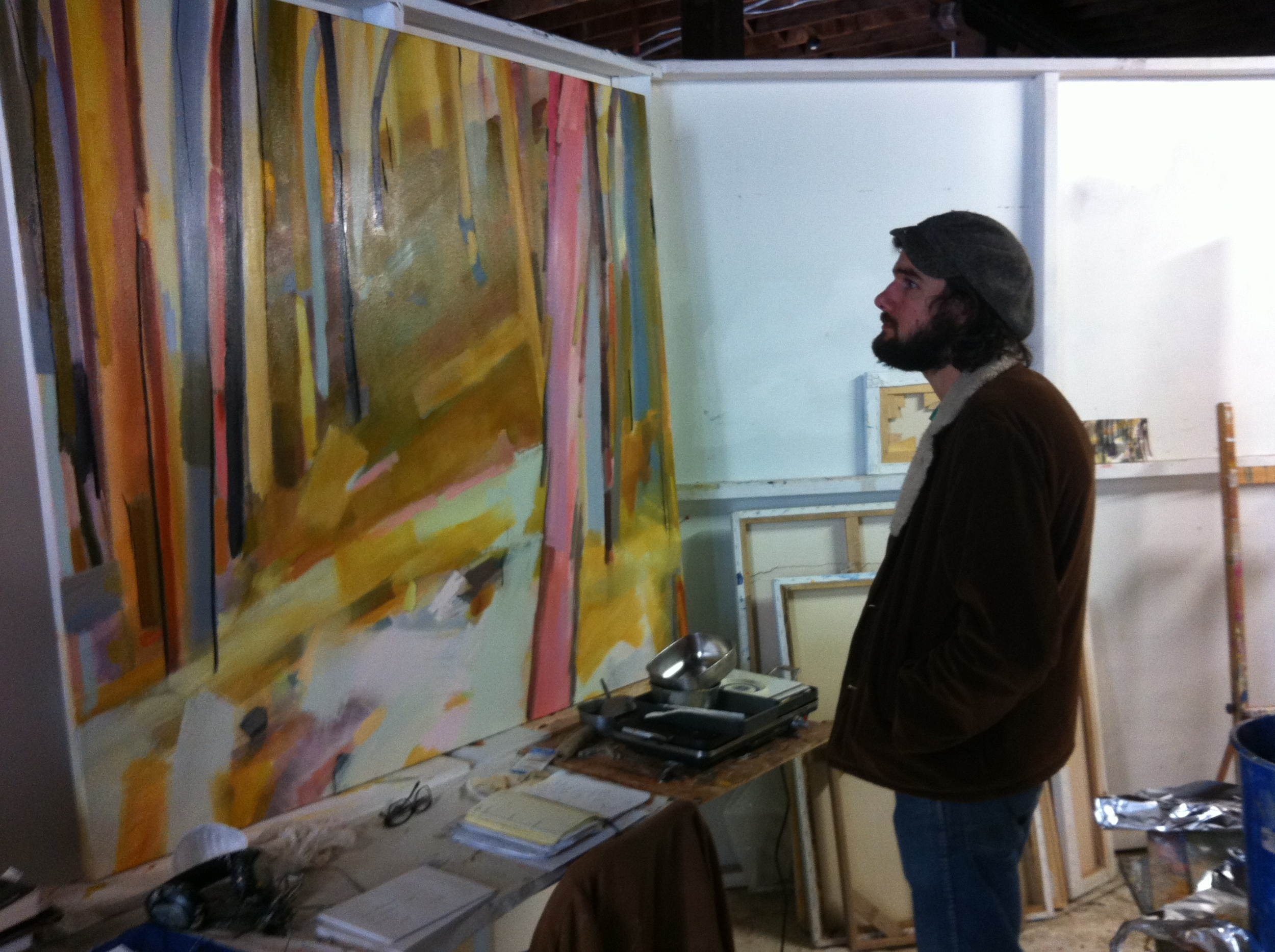 Jonathan Gaboary in the studio with oil painting