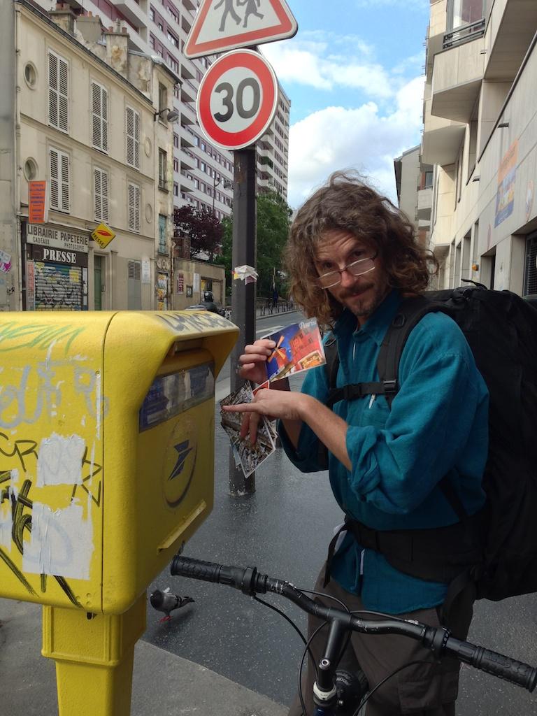 Tony sending postcards from Paris.