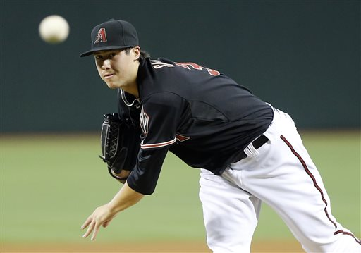 Arizona Diamondbacks pitcher Tyler Skaggs delivers a pitch against the Texas Rangers during the first inning of an inter league baseball game, Monday, May 27, 2013, in Phoenix. (AP Photo/Matt York)