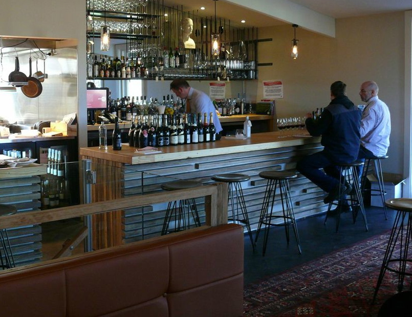 A view of the long bar at the Salopian Inn with its golden top of recycled bowling alley wood. Photo: Peter Coombs