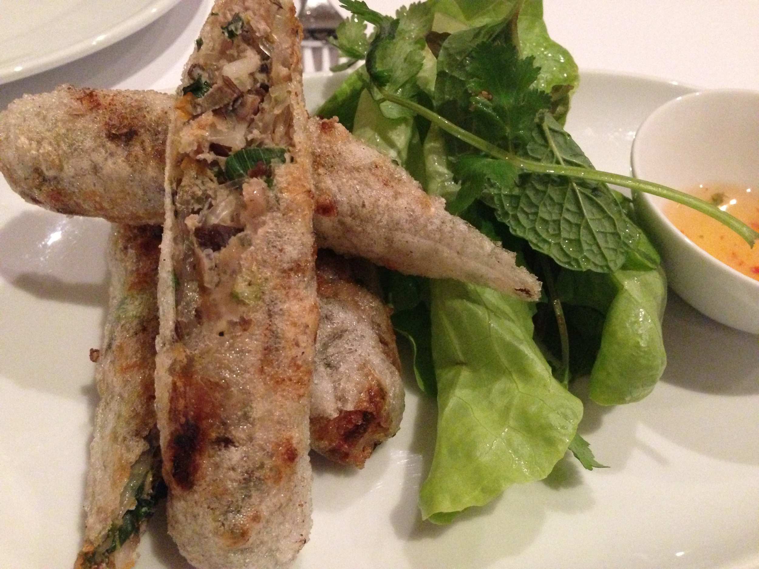 Hanoi spring rolls with salad of fresh herbs and 