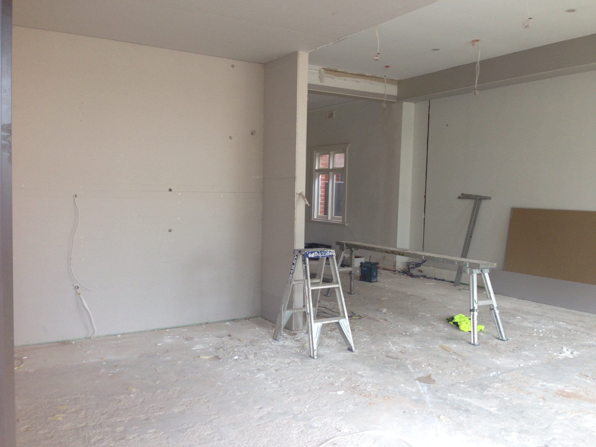 Plasterboard in the kitchen looking towards living area.