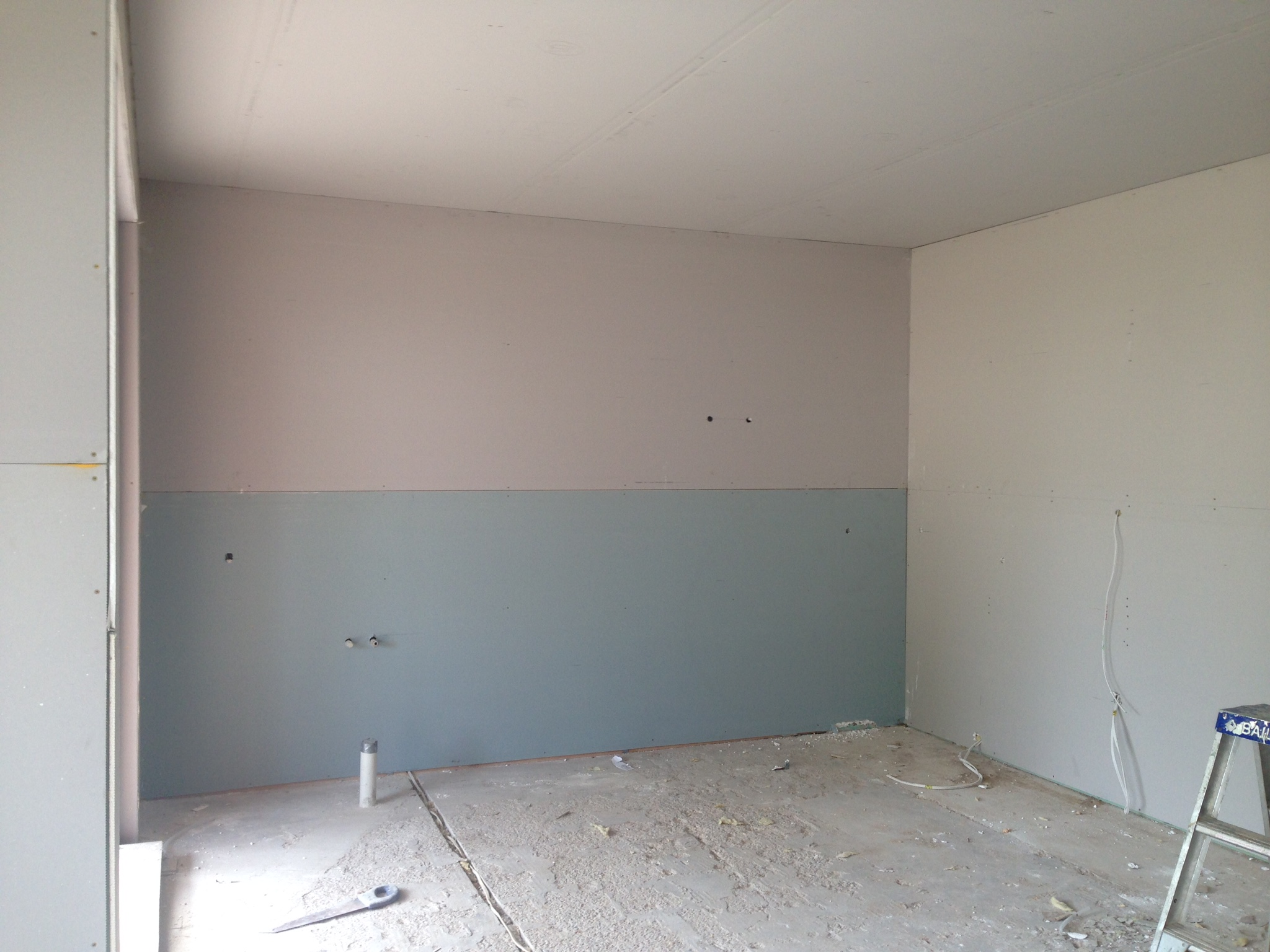 Kitchen void waiting to be filled with all that lovely veneer.