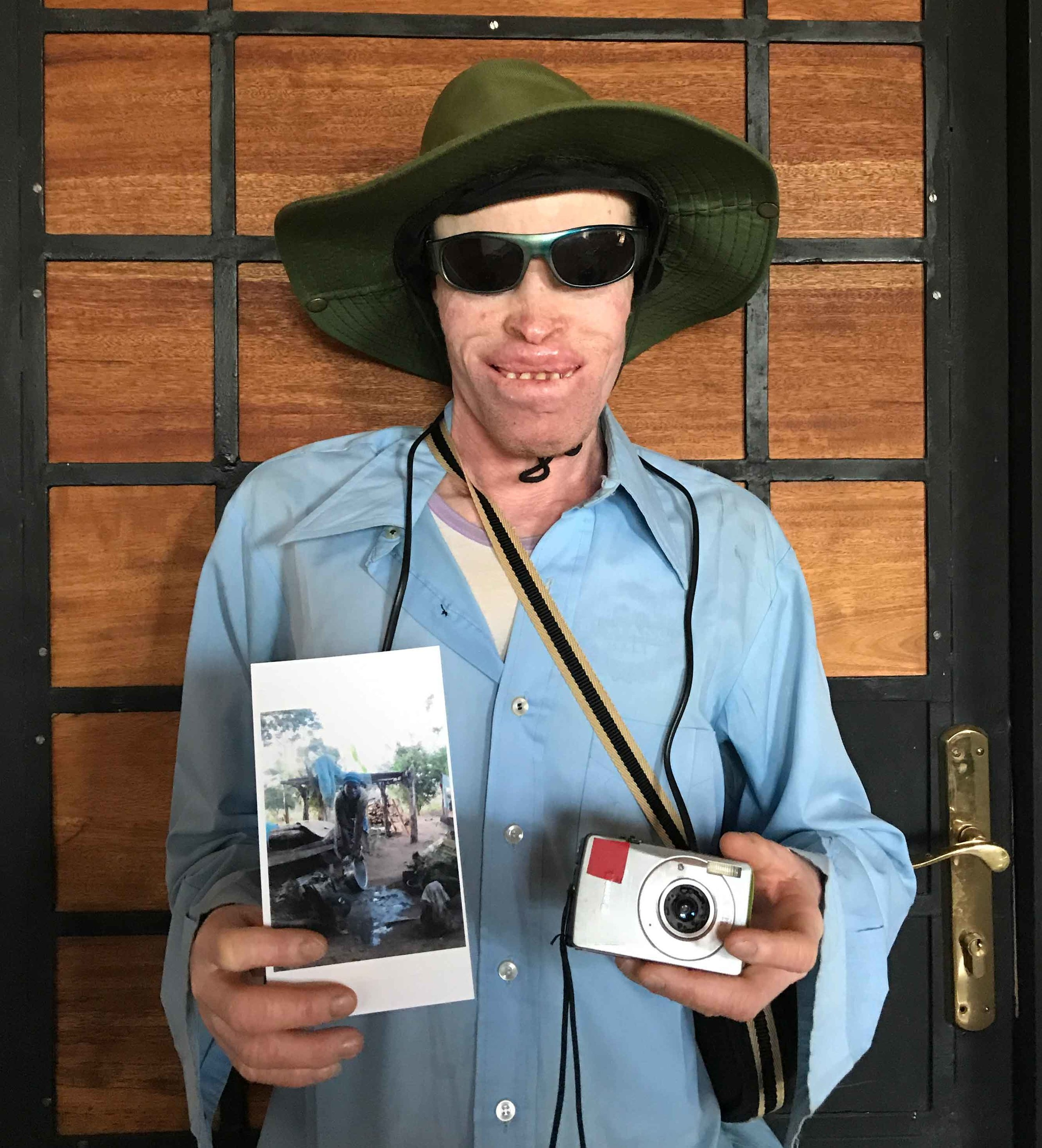 Musa holding his selected photo for the doner of his camera. Camera donated by Maral Zare from Tehran/Iran