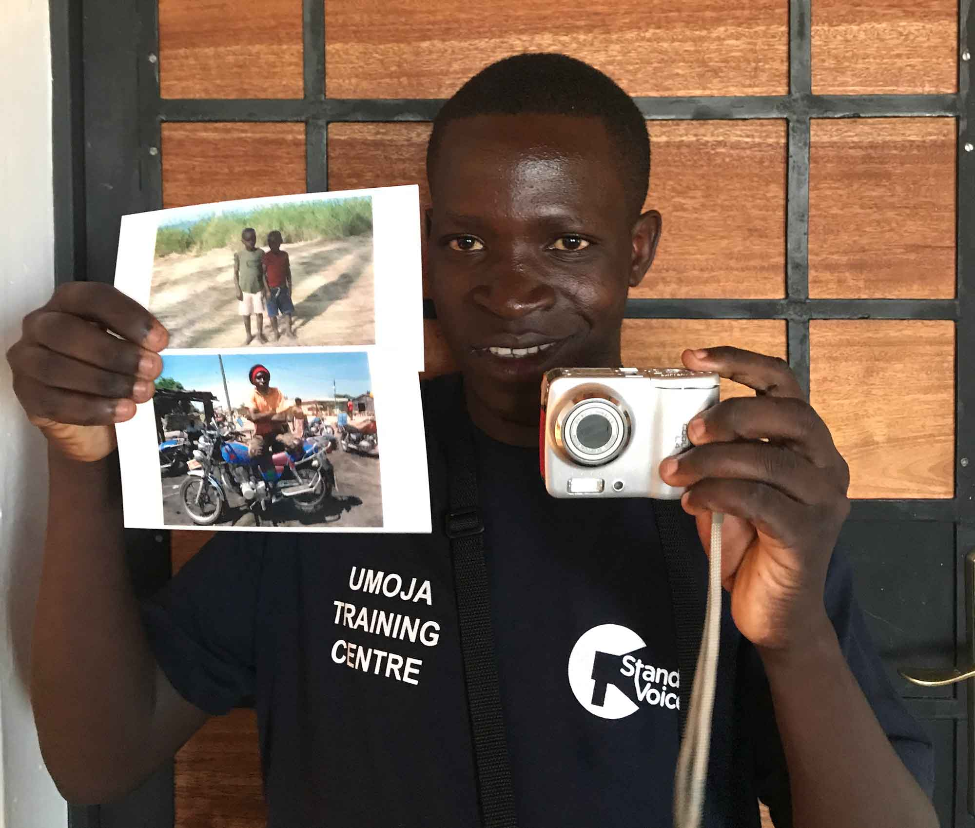 Kajala holding his selected photos for the doner of his camera. Camera donated by @Parysa_P from Tehran/Iran