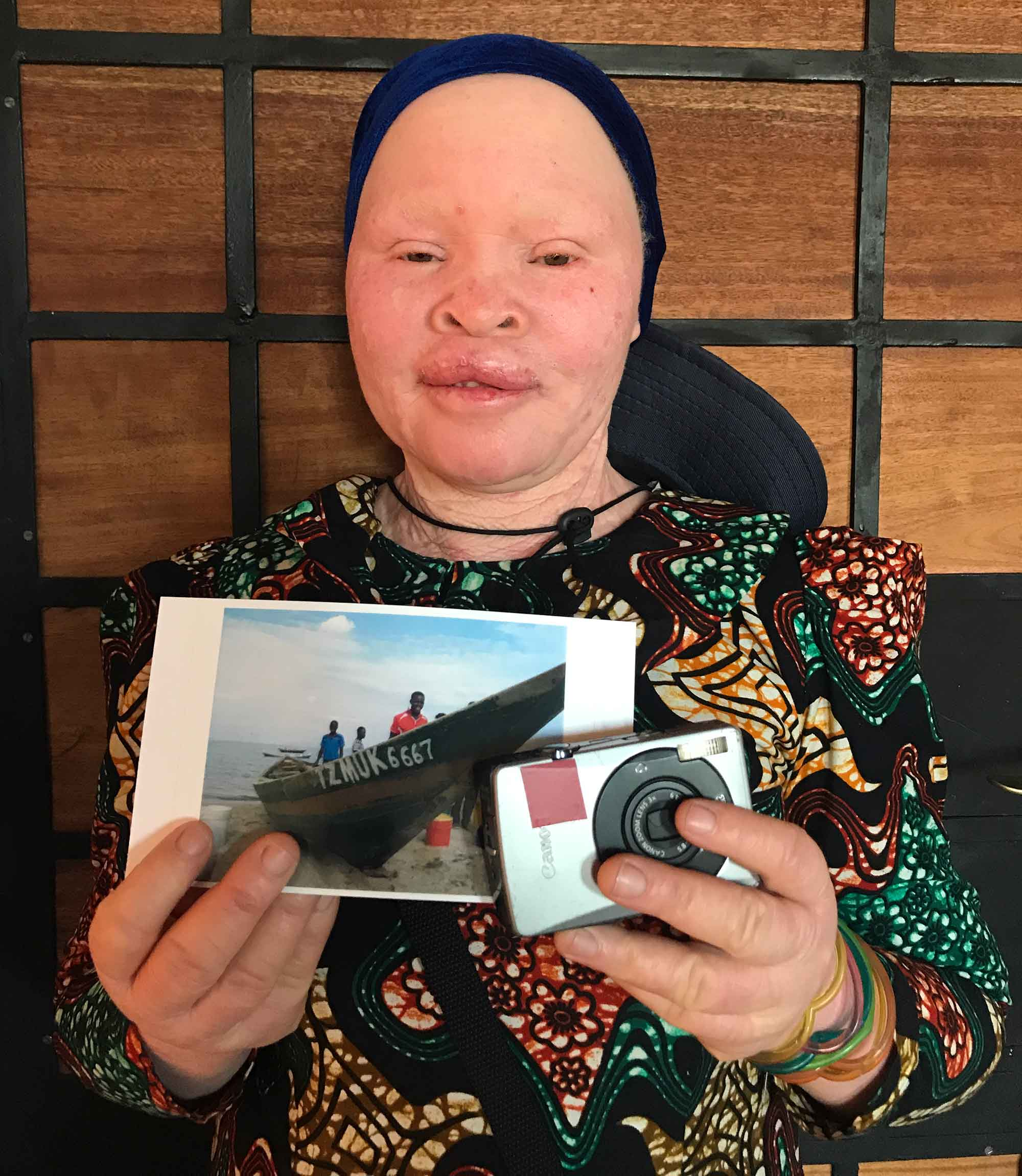 Miango holding her selected photo for the doner of her camera. Camera donated by @innuendo206 from Tehran/Iran