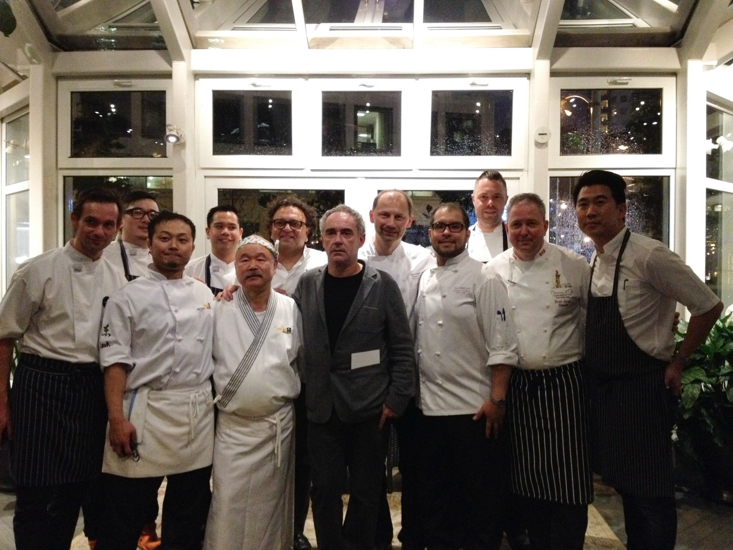 Some Vancouver chefs and their assistants with Ferran Adria, middle, on his Vancouver visit. Front row, from left, Thomas Haas, Masa Baba, Tojo Hidekazu, Adria, Ricardo Valverde, Scott Jaeger, Angus An; back row, from left, Lovett Sheng, Elmo Pinpin, Vikram Vij, Frank Pabst and Sean Cousin. Photo by Bethany Leng