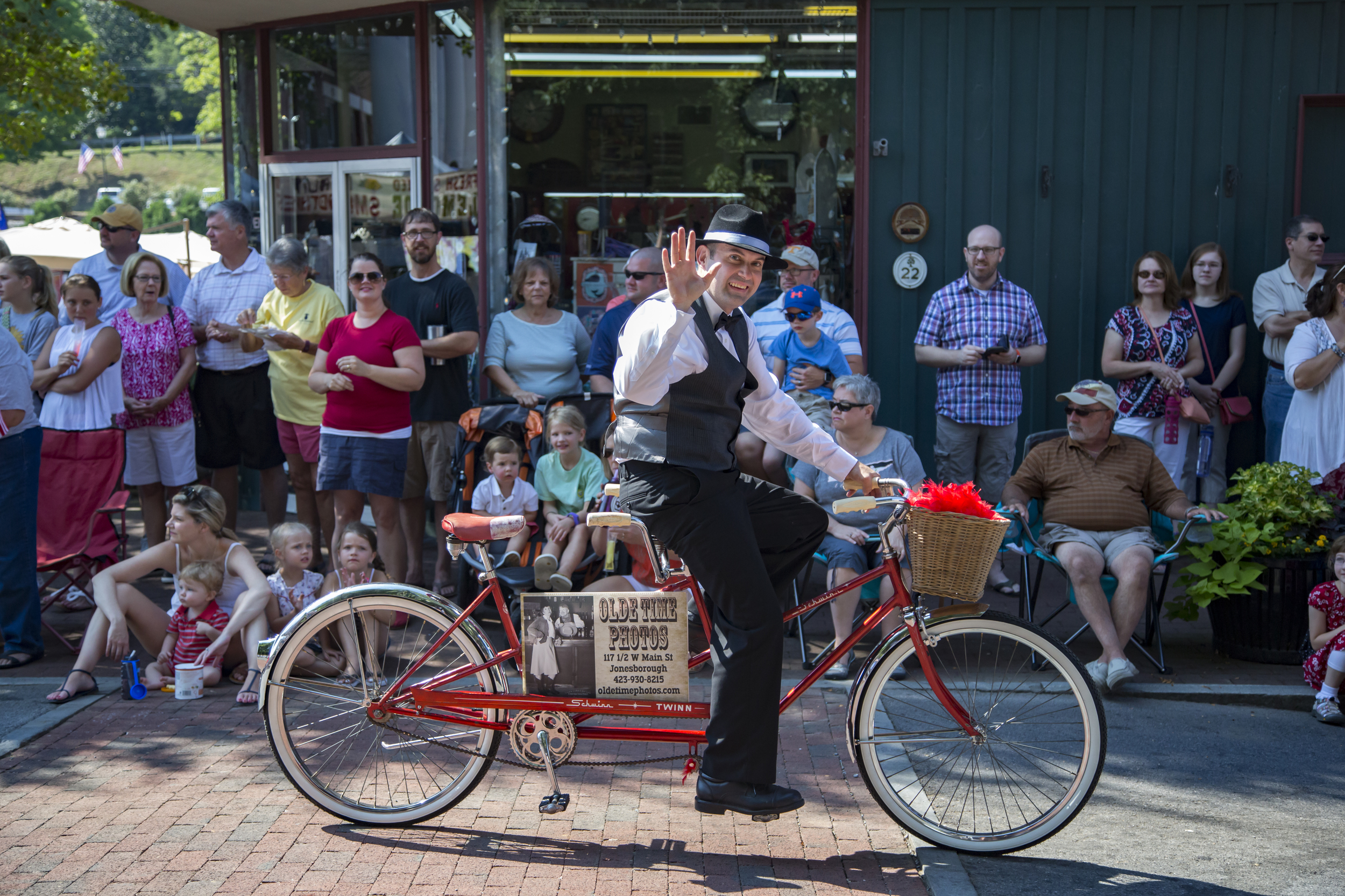 Matt from Olde Time Photos in Jonesborough, Tennessee, rides a bicycle built for two during the parade.